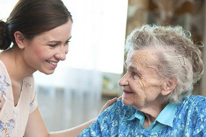 young woman interacting with elderly woman